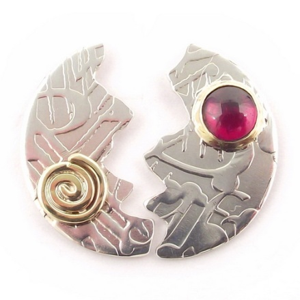 Our halved disc ear studs, featuring a garnet stone from our imprint range of jewellery.